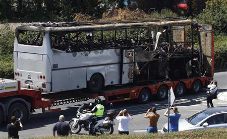 A truck carries a bus, that was damaged in a bomb blast in July 2012, outside Burgas Airport, about 400km (248 miles) east of Sofia in this July 19, 2012 file photo. REUTERS/Stoyan Nenov/Files