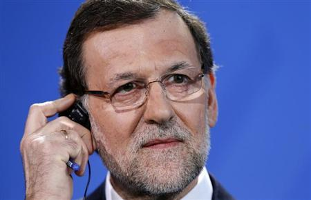 Spanish Prime Minister Mariano Rajoy addresses a news conference following talks with German Chancellor Angela Merkel at the Chancellery in Berlin February 4, 2013. REUTERS/Fabrizio Bensch