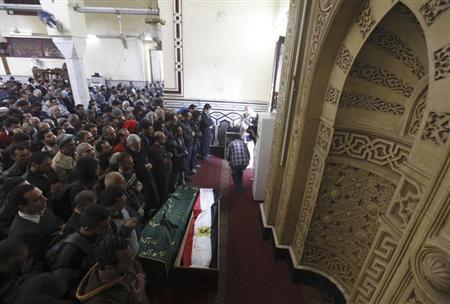Relatives of activists Mohamed al-Gendi and Amr Saad, both of whom opposed Egyptian President Mohamed Mursi, pray in front of their coffins during their funeral at Omar Makram mosque in Cairo February 4, 2013. REUTERS/Amr Abdallah Dalsh