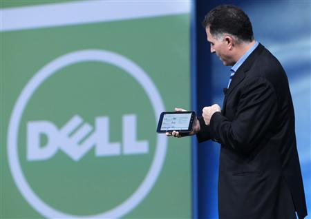 Dell founder and CEO Michael Dell displays a Dell tablet computer during his keynote address at Oracle Open World in San Francisco, California in this September 22, 2010 file photograph. REUTERS/Robert Galbraith/Files