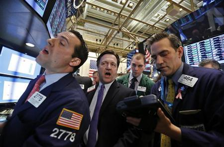 Floor governor Thomas Facchine (C) repeats a price from Getco Securities specialist trader Michael Gagliano (L) as traders await the opening of a stock on the floor of the New York Stock Exchange, February 5, 2013. REUTERS/Brendan McDermid