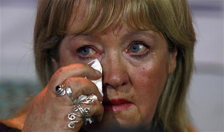 Maureen Sullivan who worked in a ''Magdalene Laundry'', wipes a tear during a ''Magdalene Survivors Together'' news conference in Dublin February 5, 2013. REUTERS/Cathal McNaughton