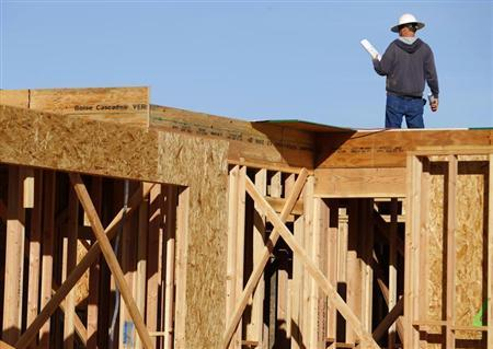 A worker builds a single-family home as construction in a new subdivision is underway in San Marcos, California, January 30, 2013. REUTERS/Mike Blake