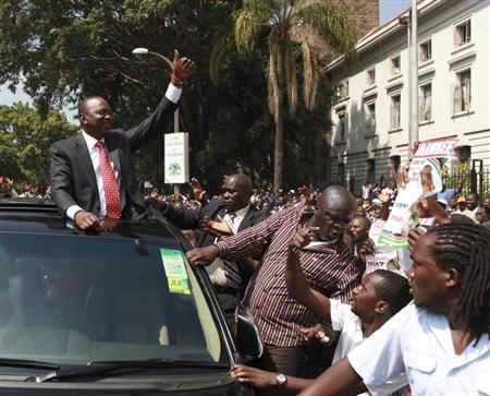 Kenya's Deputy Prime Minister Uhuru Kenyatta leaves in company of supporters after he was cleared by the Independent Electoral and Boundaries Commission (IEBC) to run for the presidency in the March 4 presidential elections in capital Nairobi in this file photo taken January 30, 2013. REUTERS/Noor Khamis