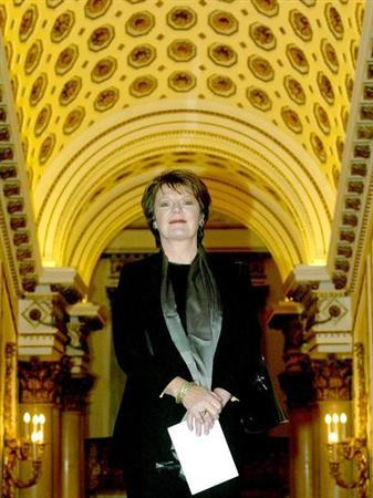 British television chef Delia Smith arrives at a reception hosted by Britain's Queen Elizabeth II and the Duke of Edinburgh to pay tribute to the contribution of more than 400 pioneers to British life at Buckingham Palace in London, October 13, 2003. REUTERS/Michael Crabtree