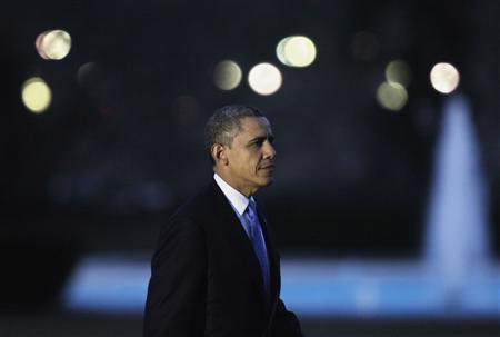 U.S. President Barack Obama walks on the South Lawn of the White House upon his return to Washington from Minneapolis, Minnesota February 4, 2013. REUTERS/Yuri Gripas