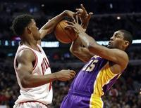 Chicago Bulls small forward Jimmy Butler (L) blocks the shot of Los Angeles Lakers small forward Metta World Peace during the first half of their NBA basketball game in Chicago, Illinois January 21, 2013. REUTERS/Jeff Haynes