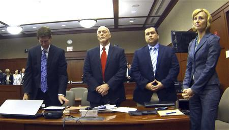 George Zimmerman (2nd R) is pictured with his attorneys Mark O'Mara (L), Don West, and Lorna Truett (R) in Seminole circuit court in Sanford, Florida February 5, 2013. REUTERS/Joe Burbank/Pool