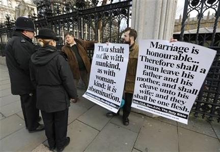 Born-again Christian activist Carl Hamblin protests outside the Houses of Parliament before a free vote on gay marriage, London February 5, 2013. REUTERS/Chris Helgren