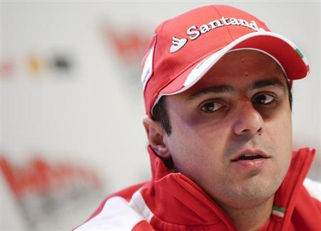 Ferrari Formula One driver Felipe Massa of Brazil looks on during a news conference at the Wrooom, F1 and MotoGP Press Ski Meeting, Ducati and Ferrari's annual media gathering, in Madonna di Campiglio January 17, 2013. REUTERS/Max Rossi/Files