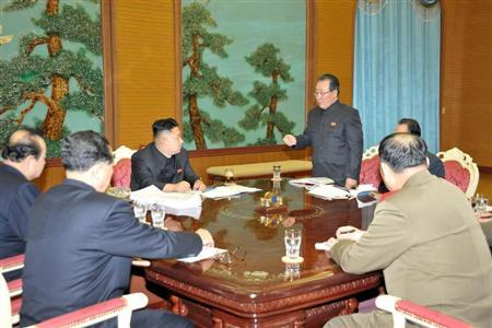 North Korean leader Kim Jong-Un (C) presides over a consultative meeting with officials about state security and foreign affairs in this undated recent picture released by North Korea's official KCNA news agency in Pyongyang on January 27, 2013. REUTERS/KCNA