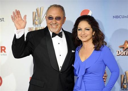 Cuban singer Gloria Estefan and her husband, producer Emilio Estefan Jr., arrive at the 2011 National Council of La Raza ALMA Awards in Santa Monica, California September 10, 2011. REUTERS/Gus Ruelas/Files