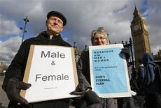 Christian activists Jonathan Longstaff (L) and Jenny Rose, both from London, protest outside the Houses of Parliament before a free vote on gay marriage, London February 5, 2013. REUTERS/Chris Helgren