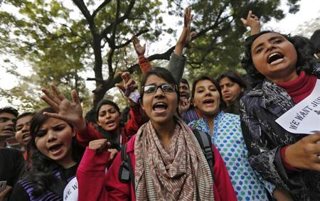 Demonstrators shout slogans and raise their hands during a protest for a gang rape victim, who was assaulted in New Delhi January 16, 2013. REUTERS/Adnan Abidi/Files