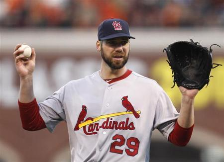 St. Louis Cardinals starting pitcher Chris Carpenter looks to catcher Yadier Molina in the fourth inning as he pitches against the San Francisco Giants in Game 6 of their MLB NLCS playoff baseball series in San Francisco, October 21, 2012. REUTERS/Robert Galbraith