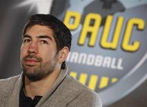 Nikola Karabatic, former Montpellier handball club player, attends a news conference at the PAUC Handball club in Aix-en-Provence, Febuary 2, 2013. REUTERS/Philippe Laurenson