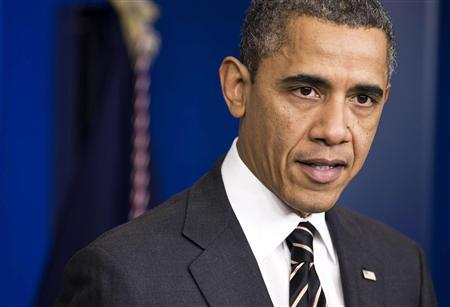 U.S. President Barack Obama calls on Congress to pass a small package of spending cuts and tax reforms that would delay the larger, automatic ''sequester'' cuts from going into effect during an announcement in the White House briefing room in Washington February 5, 2013. REUTERS/Joshua Roberts (UNITED STATES - Tags: POLITICS BUSINESS)