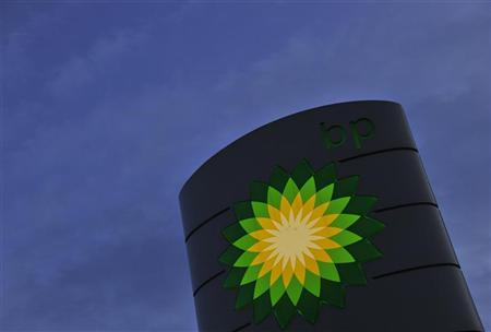 A BP petrol station sign is seen at dawn in west London October 25, 2011. REUTERS/Toby Melville