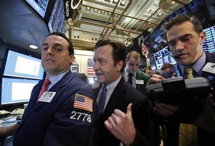 Floor governor Thomas Facchine (C) talks with Getco Securities specialist trader Michael Gagliano (L) on the floor of the New York Stock Exchange, February 5, 2013. REUTERS/Brendan McDermid