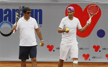 Spanish tennis player Rafael Nadal (R) attends a training session with his uncle and coach Toni Nadal, at country club Las Salinas in Vina del Mar City, about 121 km (75 miles) northwest of Santiago, February 4, 2013. REUTERS/Eliseo Fernandez