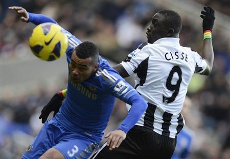 Newcastle United's Papiss Cisse (R) challenges Chelsea's Ashley Cole during their English Premier League soccer match in Newcastle, northern England February 2, 2013. REUTERS/Nigel Roddis
