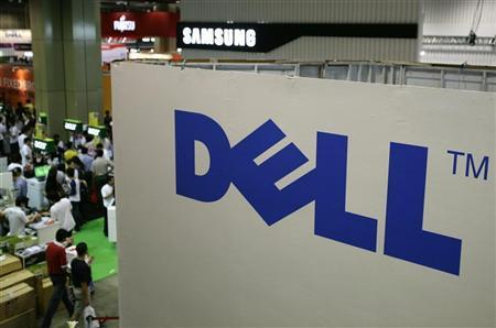 Shoppers walk past a Dell booth at the COMEX information technology and consumers technology exhibition in Singapore August 28, 2008. REUTERS/Tim Chong/Files