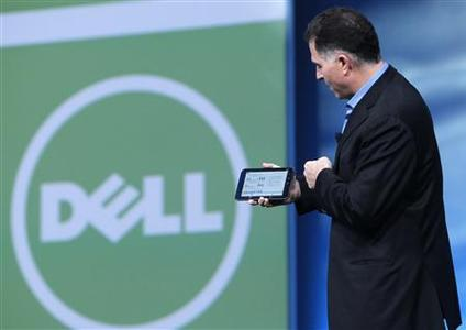 Dell founder and CEO Michael Dell displays a Dell tablet computer during his keynote address at Oracle Open World in San Francisco, California in this September 22, 2010 file photograph. Computer maker Dell Inc will go private in a $24.4 billion deal that also involves Microsoft Corp and private equity firm Silver Lake, the parties said on February 5, 2013. REUTERS/Robert Galbraith/Files