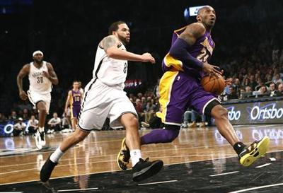 Short-handed Lakers maintain dominance of Nets