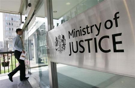 A man enters The Ministry of Justice in London June 19, 2007. REUTERS/James Boardman