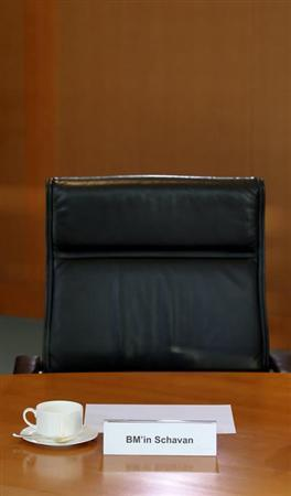 The empty seat of German Education Minister Annette Schavan is pictured before the cabinet meeting at the Chancellery in Berlin, February 6, 2013. Chancellor Angela Merkel's education minister was stripped of her doctorate on Tuesday for alleged plagiarism in her work, a move that could embarrass the German leader as she seeks election to a third term in office. REUTERS/Fabrizio Bensch (GERMANY - Tags: POLITICS)