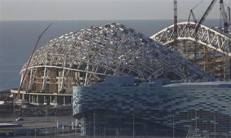 A view of the Fisht Olympic Stadium (L) and Iceberg Skating Palace under construction in the Olympic Park to be used for the Sochi 2014 Winter Olympics, in Sochi December 9, 2012. REUTERS/Pawel Kopczynski