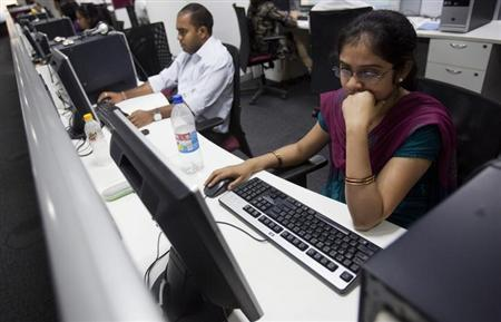 Employees work on their computer terminals on the floor of an outsourcing centre in Bangalore February 29, 2012. REUTERS/Vivek Prakash/Files