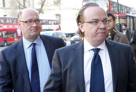 The Group Chief Executive of HSBC Stuart Gulliver (R) arrives with Chairman Douglas Flint to give evidence to the Parliamentary Commission on Banking Standards at Portcullis House in central London February 6, 2013. REUTERS/Andrew Winning