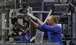 A worker is pictured at the production of steering gears at a plant of Germany's industrial conglomerate ThyssenKrupp AG in the western city of Muelheim January 16, 2013. REUTERS/Ina Fassbender (GERMANY - Tags: BUSINESS INDUSTRIAL)