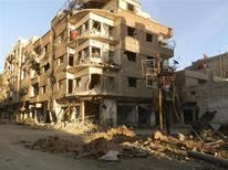 A view of damaged buildings after what activists said was shelling by forces loyal to Syria's President Bashar al-Assad in Daraya February 4, 2013, in this picture provided by Shaam News Network. Picture taken February 4, 2013. REUTERS/Fadi Al-Derani/Shaam News Network (SYRIA - Tags: CONFLICT POLITICS) ATTENTION EDITORS - THIS PICTURE WAS PROVIDED BY A THIRD PARTY. REUTERS IS UNABLE TO INDEPENDENTLY VERIFY THE AUTHENTICITY, CONTENT, LOCATION OR DATE OF THIS IMAGE. FOR EDITORIAL USE ONLY. NOT FOR SALE FOR MARKETING OR ADVERTISING CAMPAIGNS. THIS PICTURE IS DISTRIBUTED EXACTLY AS RECEIVED BY REUTERS, AS A SERVICE TO CLIENTS