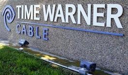 Time Warner a fait état mercredi d'un bénéfice en hausse pour le quatrième trimestre, ses activités dans les réseaux câblés ayant compensé un recul de ses revenus dans le cinéma, la télévision et la publicité. /Photo prise le 5 novembre 2012/REUTERS/Mike Blake