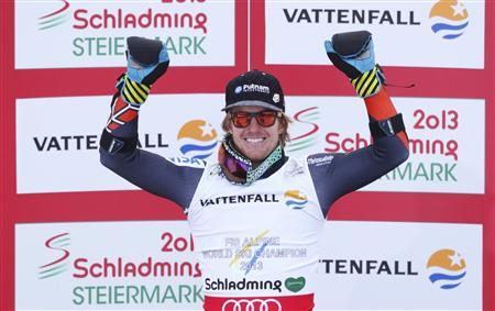 Gold medallist Ted Ligety of the U.S. reacts on the podium after the men's Super G race at the World Alpine Skiing Championships in Schladming February 6, 2013. REUTERS/Ruben Sprich