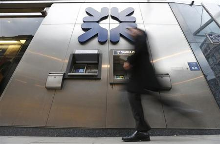 A pedestrian walks past a branch of the Royal Bank of Scotland (RBS) in the City of London February 4, 2013. Royal Bank of Scotland will be punished on February 6, 2013 for its role in a global interest rate rigging scandal, with fines of between 400-500 million pounds ($783 million) expected. The part-nationalised bank will be fined by authorities in Britain and the United States for the attempted manipulation of the London interbank offered rate (Libor) and other key benchmark rates. Photograph taken on February 4, 2013. REUTERS/Andrew Winning (BRITAIN - Tags: BUSINESS POLITICS)