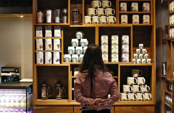 A visitor looks at products on display during the launch of the first Starbucks store in New Delhi, February 6, 2013. REUTERS/Adnan Abidi