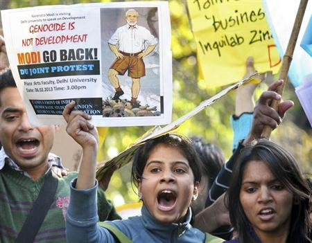 Demonstrators shout slogans as they hold placards during a protest against Gujarat Chief Minister Narendra Modi outside a college in New Delhi February 6, 2013. REUTERS/Stringer