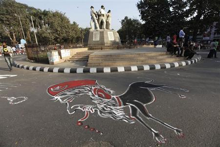 A cartoon of Bangladesh's Jamaat-e-Islami senior leader Abdul Quader Mollah is drawn on the street of university of Dhaka as students demand capital punishment for him, after a war crimes tribunal sentenced him to life imprisonment, in Dhaka February 6, 2013. REUTERS/Andrew Biraj