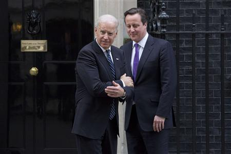 Britain's Prime Minister David Cameron (R) bids farewell to U.S. Vice President Joe Biden at Number 10 Downing Street in London February 5, 2013. REUTERS/Neil Hall