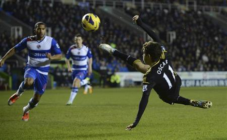 Chelsea's Oscar (R) makes a shot during their English Premier League soccer match against Reading at the Madejski Stadium in Reading, England January 30, 2013. REUTERS/Philip Brown