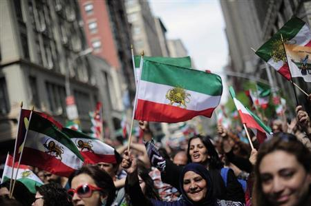 Marchers carry pre-Islamic Revolution flags of Iran as they march in the Persian Day Parade in New York, April 15, 2012. The parade is held in commemoration of Newroz, the Persian New Year. REUTERS/Keith Bedford/Files