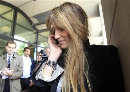 Socialite and activist Jemima Khan arrives to attend a parliamentary committee hearing on phone hacking at Portcullis House in London July 19, 2011. REUTERS/Suzanne Plunkett/Files