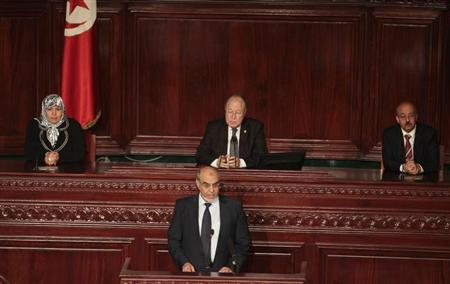 Tunisian Prime Minister Hamadi Jebali (front) gives a speech at the Constituent Assembly during an event marking the second year anniversary of the revolution in Tunis January 14, 2013. REUTERS/Zoubeir Souissi
