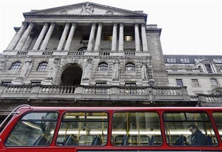 A man sits on a bus as it passes the Bank of England in the financial district of the City of London January 29, 2013. REUTERS/Luke Macgregor