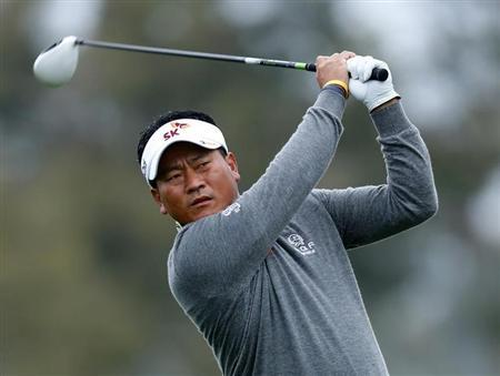 South Korean golfer K.J. Choi hits off the 2nd tee during weather delayed third round play at the Farmers Insurance Open in San Diego, California January 27, 2013. REUTERS/Mike Blake