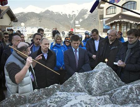 Russia's President Vladimir Putin (2nd L) listens to Interros Company President Vladimir Potanin (L) as he visits the Rosa Khutor Alpine Center in Rosa Khutor outside the Black Sea resort of Sochi, February 6, 2013. Putin on Wednesday toured objects of the Olympic mountain cluster, which will host the 2014 Winter Olympic Games. REUTERS/Ivan Sekretarev/Pool
