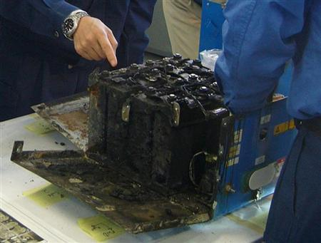 The burnt auxiliary power unit battery, removed from an All Nippon Airways' (ANA) Boeing Co 787 Dreamliner plane which made an emergency landing on January 16, 2013 in Takamatsu, is inspected by the manufacturer at the headquarters of GS Yuasa Corp in Kyoto, western Japan, in this handout photo taken on January 26, 2013 and released by the Japan Transport Safety Board (JTSB) February 5, 2013. REUTERS/Japan Transport Safety Board/Handout
